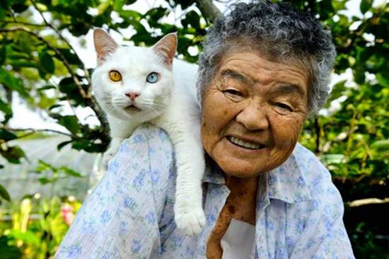 Japanese grandmother Misao with cat on shoulder